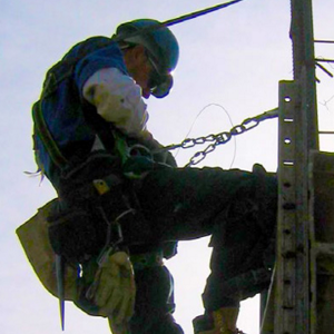 Construction worker suspended from fall safety harness