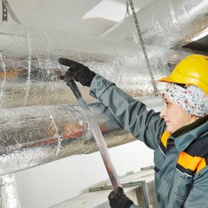 Construction worker applying FSK tape