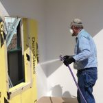 Spraying Liquid Air Barrier on Building Wall Panel